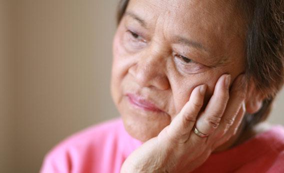 Sad elderly woman.