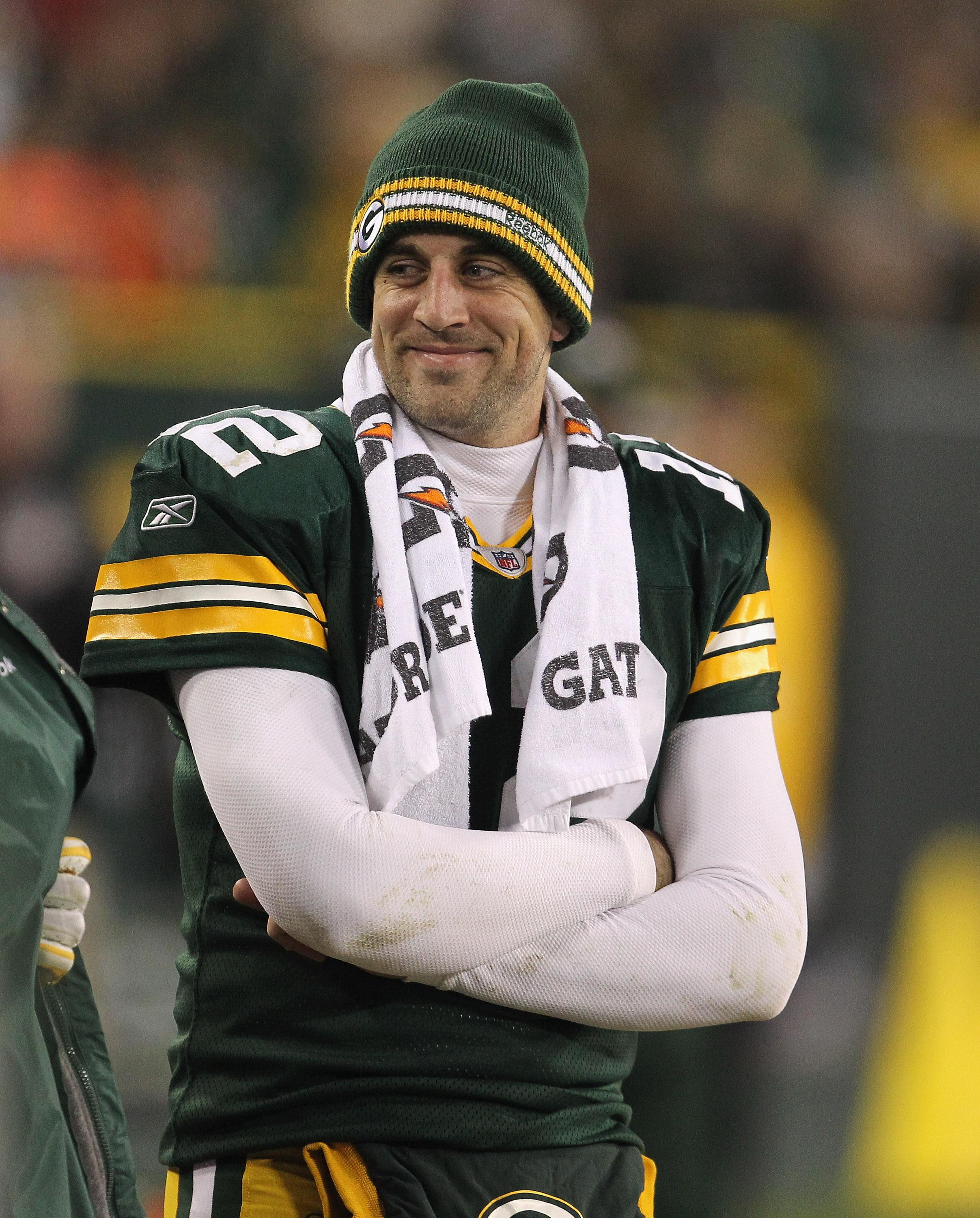 Aaron Rodgers smiles on the sidelines during Green Bay's 45-7 win over Minnesota