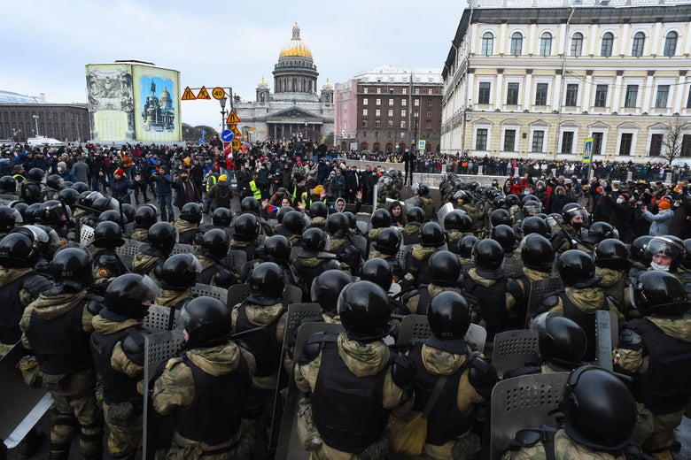 Law enforcement officers block protesters during a rally in support of jailed opposition leader Alexei Navalny in Saint Petersburg on January 31, 2021.