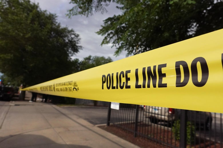 Police tape surrounds a crime scene where three people were shot at the Wentworth Gardens housing complex in the Bridgeport neighborhood on June 23, 2021 in Chicago, Illinois.