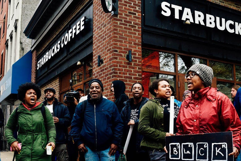 Protesters gather on Monday at the Starbucks location in Philadelphia where two black men were arrested.