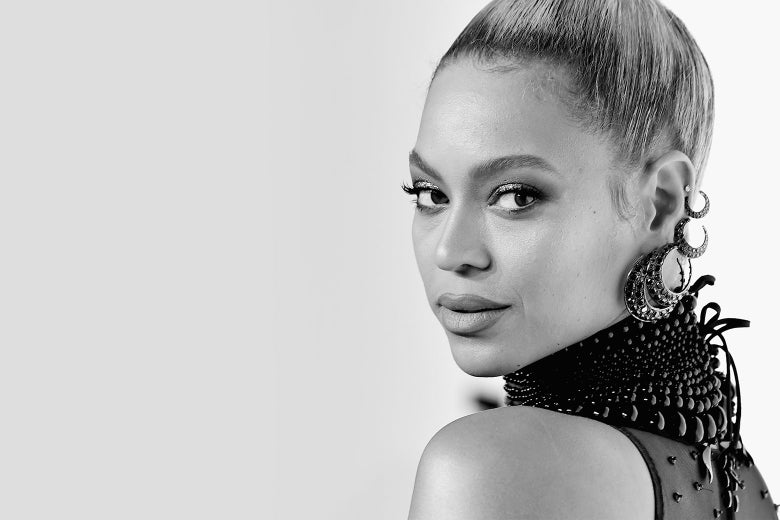 Beyone looks over her shoulder at the camera in a black-and-white photo.