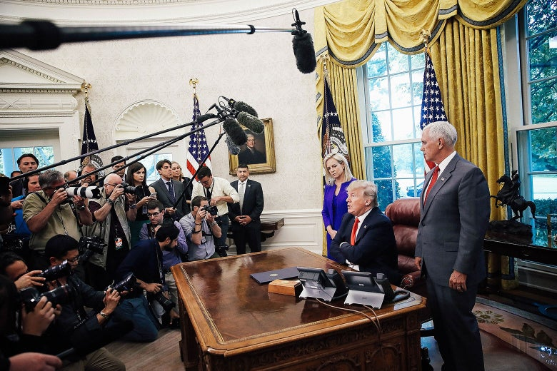 President Donald Trump, accompanied by Department of Homeland Security Secretary Kirstjen Nielsen and Vice President Mike Pence.