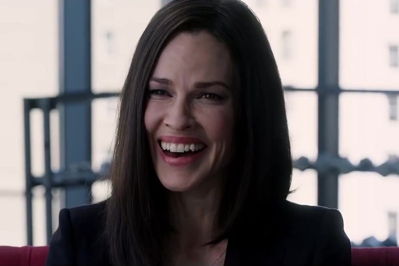 Hilary Swank, laughing.