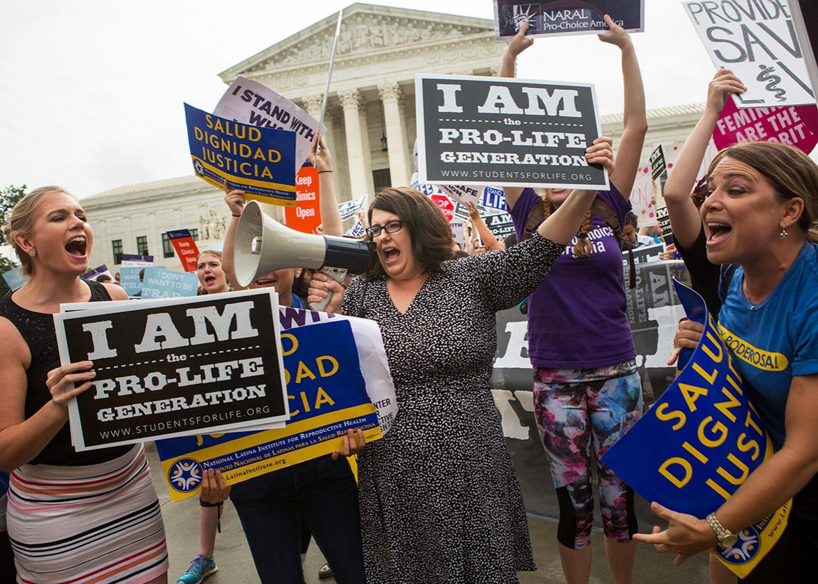 Kristan Hawkins, president of Students for Life, center, and other pro-life protesters clash with pro-choice protesters in front of the U.S. Supreme Court on a day where two important decisions on immigration and affirmative action were handed down by the court, on June 23, 2016 in Washington, DC.