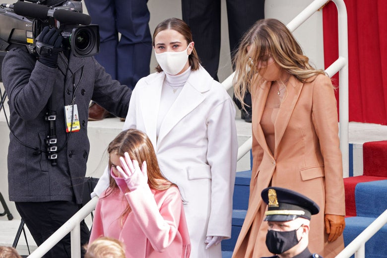 Three young women each in monochromatic outfits. One in white, another in pink, and the third in beige.