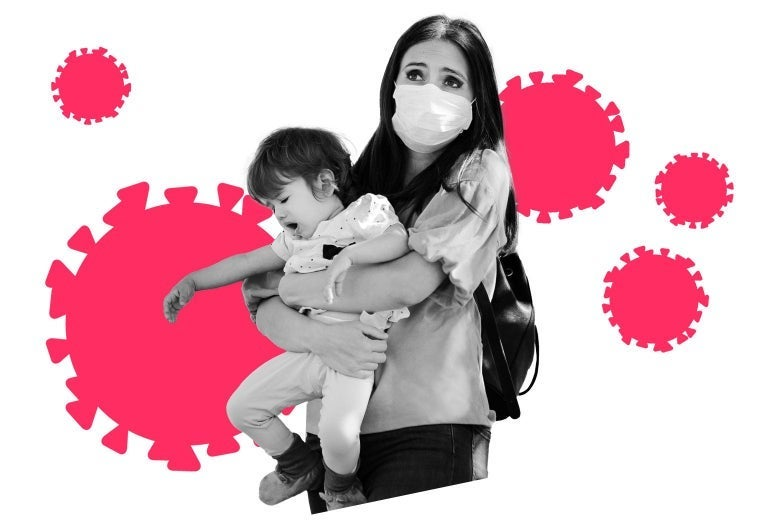 Woman in a mask holds a baby with illustrated coronavirus molecules in the background.