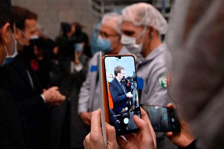 Emmanuel Macron is filmed on a smartphone.