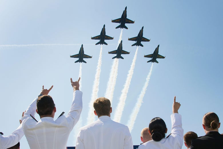 United States Naval Academy midshipmen cheer as the US Navy's Blue Angels fly over the graduation ceremony in Annapolis, Maryland, on May 25, 2018.