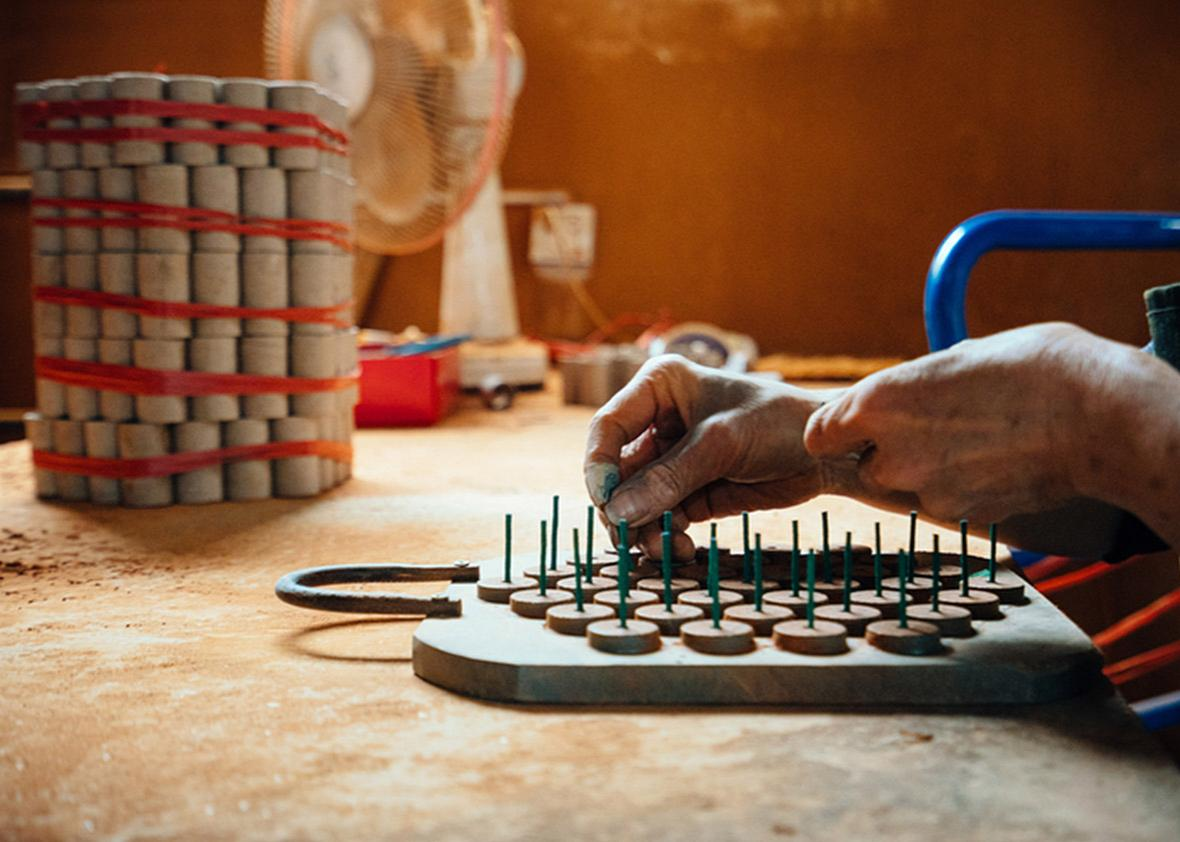 China Makes Most Of The Worlds Fireworksand Bears Danger Wiring Money A Worker Assembles Firework Components By Inserting Lead Wires While At Wanle Fireworks Factory In Bixi Village On May 11