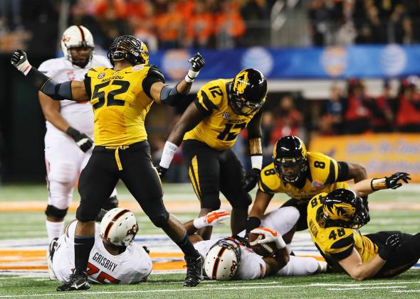 Mike Sams, No. 52, reacts to a defensive play in the 2014 Cotton Bowl.