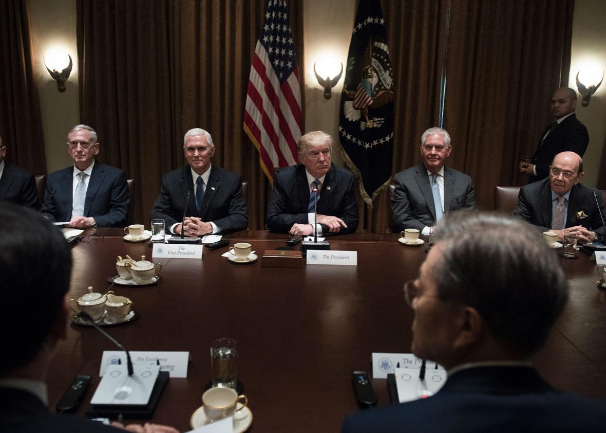 National Security Adviser H.R. McMaster, Secretary of Defense James Mattis, Vice President Mike Pence, President Donald Trump, Secretary of State Rex Tillerson, South Korea's President Moon Jae-in, and Secretary of Commerce Wilbur Ross wait for a meeting in the Cabinet Room of the White House on June 30.