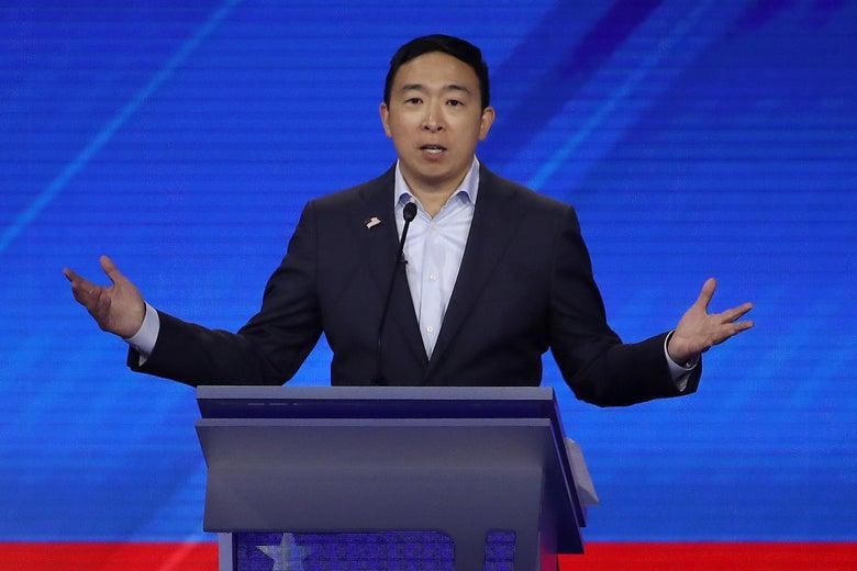 Andrew Yang on a debate stage.