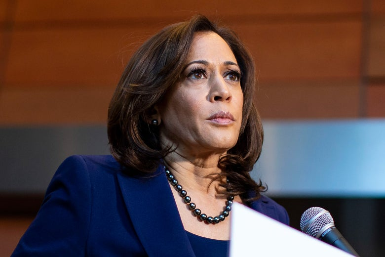 Kamala Harris at a microphone.
