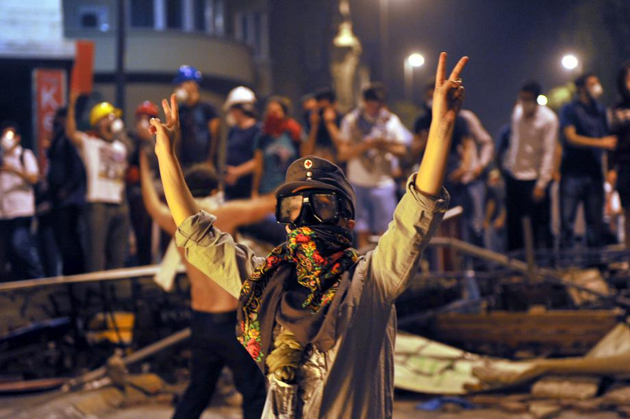 A protestor flashes a V-sign during the clashes near Taksim in Istanbul on June 3, 2013.