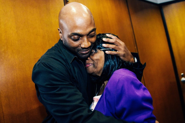 Lamarr Monson, hugs his mother, Delores Monson, after all charges were dismissed against him in the 1996 slaying of 12-year-old Detroiter Christina Brown.