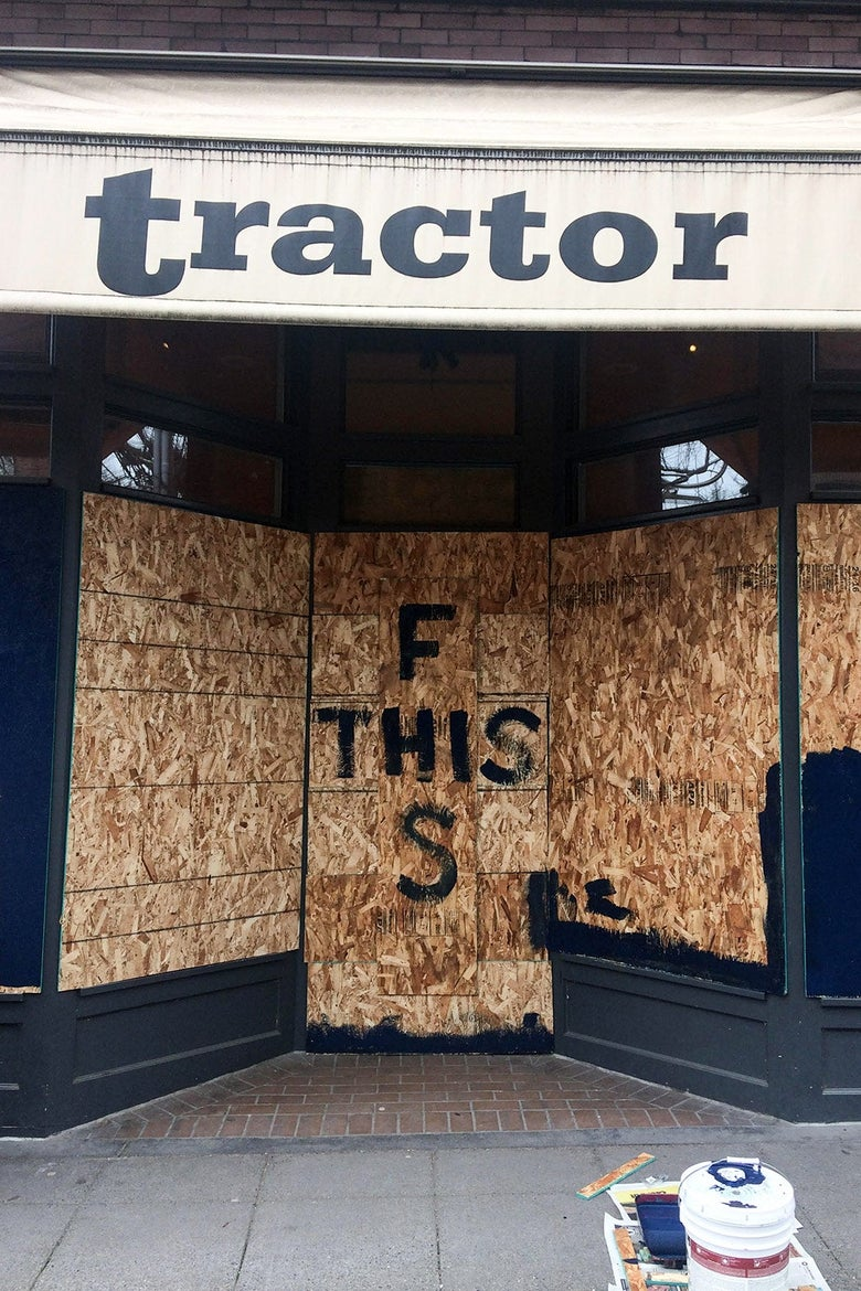 "Boarded-up windows say ""F This S."""