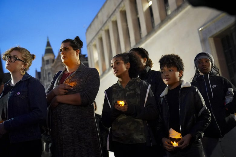 Protesters hold candles outside the Virginia State Capitol.