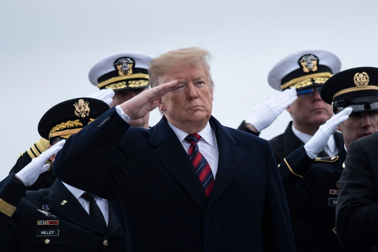 President Trump salutes while standing in front of officers at Dover Air Force Base Jan. 19, 2019 in Dover, Delaware.