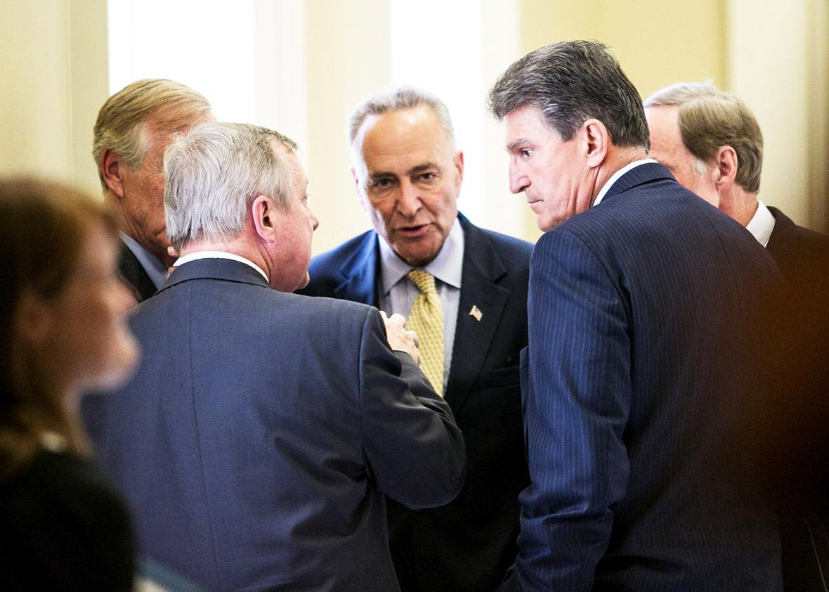 (L-R) Sen. Angus King (I-ME), Sen. Dick Durbin (D-IL), Sen. Chuck Schumer (D-NY), Sen. Tom Carper (D-DE) and Sen. Joe Manchin (D-WV) speak with each other after a closed-door meeting with fellow Democratic Senators, on Capitol Hill, July 9, 2013 in Washington, DC.