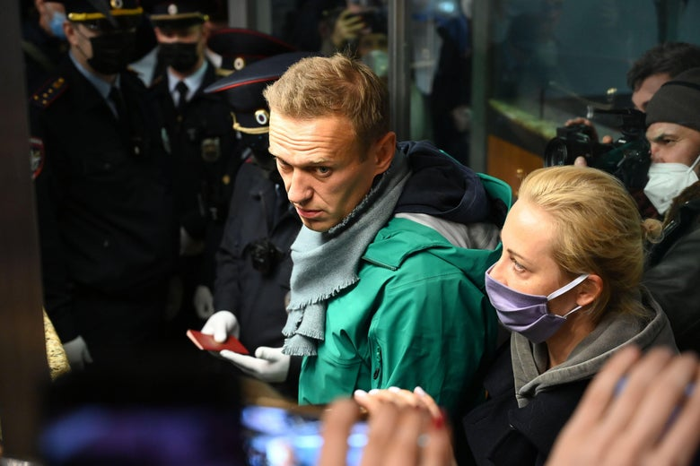 Russian opposition leader Alexei Navalny and his wife Yulia are seen at the passport control point at Moscow's Sheremetyevo airport on January 17, 2021.