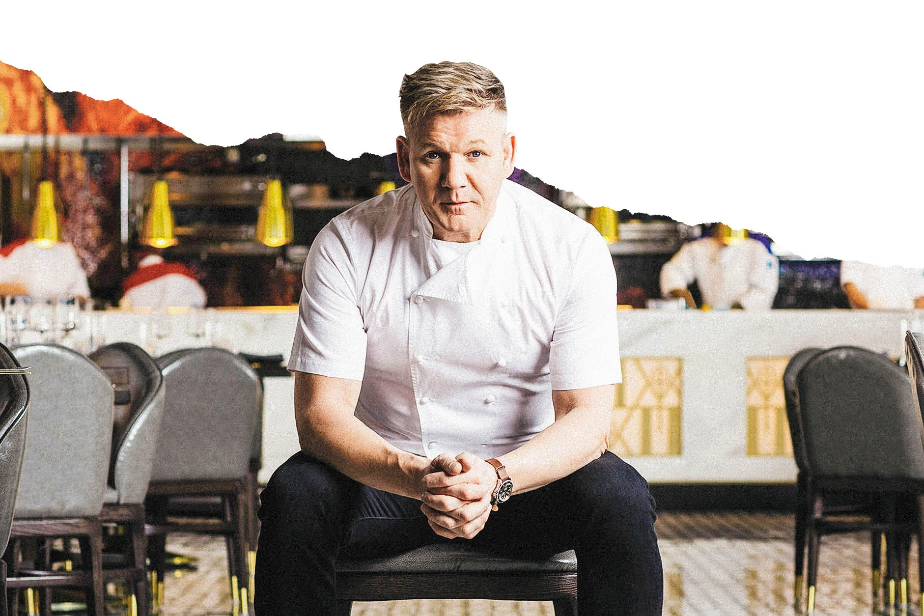 Gordon Ramsay facing forward, sitting in a chair in a restaurant.