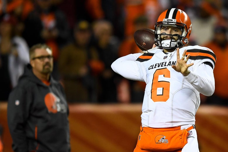 DENVER, CO - DECEMBER 15:  Quarterback Baker Mayfield #6 of the Cleveland Browns warms up as head coach Gregg Williams of the Cleveland Browns looks on before a game against the Denver Broncos at Broncos Stadium at Mile High on December 15, 2018 in Denver, Colorado. (Photo by Dustin Bradford/Getty Images)