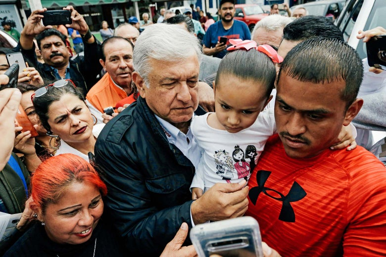 Andres Manuel Lopez Obrador of the National Regeneration Movement (MORENA) poses for a photo with supporters as he arrives at a campaign rally in Nuevo Laredo, Mexico April 5, 2018.