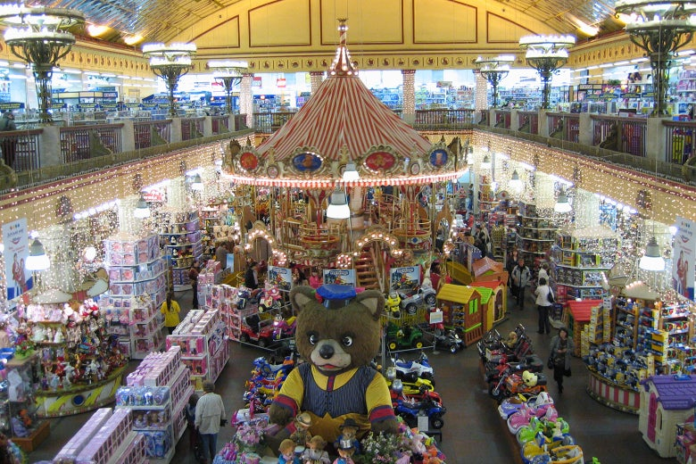 The interior of the Detsky Mir department store, featuring a merry-go-round and a giant teddy bear.