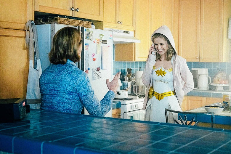 A still image from The Boys with a female superhero on the phone in her kitchen.