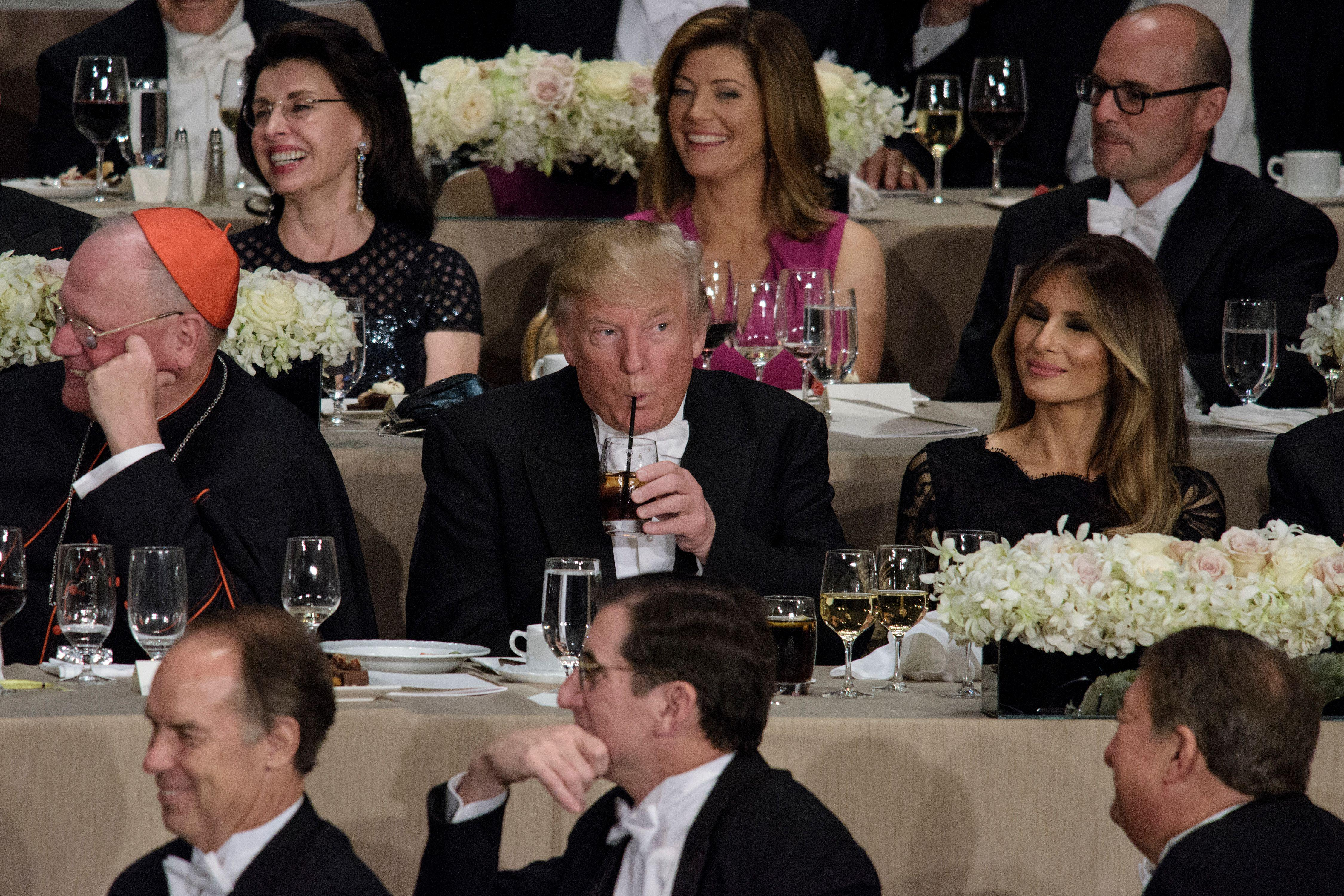 From left Cardinal Timothy Dolan, Archbishop of New York, Republican presidential nominee Donald Trump, Melania Trump and others listen as Democratic presidential nominee Hillary Clinton speaks during the Alfred E. Smith Memorial Foundation Dinner at Waldorf Astoria October 20, 2016 in New York, New York. / AFP / Brendan Smialowski        (Photo credit should read BRENDAN SMIALOWSKI/AFP/Getty Images)