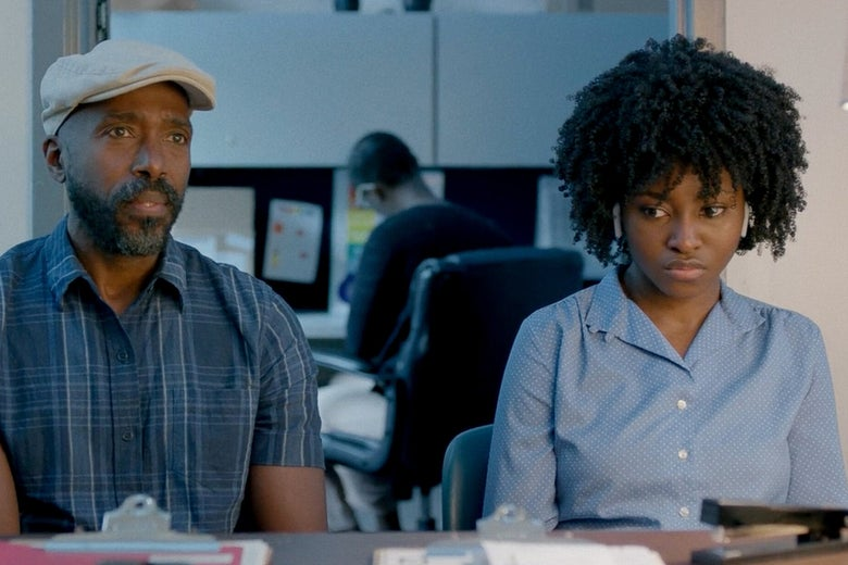 Ntare Mwine and Jayme Lawson sit behind a desk.