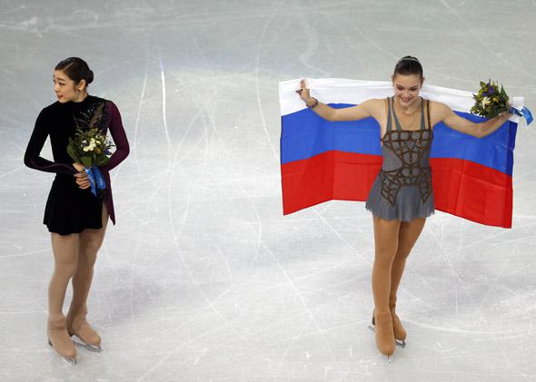 Gold medalist Adelina Sotnikova, right, and Youna Kim pose during the flower ceremony after Thursday's free skate at the Sochi Games.