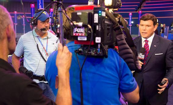 Fox News anchor Bret Baier speaks in front of the camera at the 2012 Republican National Convention in Tampa, Fla.