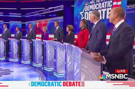 Only Bill de Blasio and Elizabeth Warren raise their hands in the row of debaters.