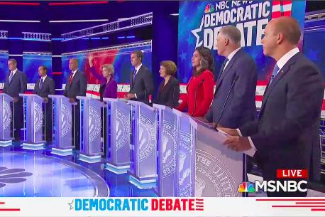 Only Bill de Blasio and Elizabeth Warren raise their hands in the row of debaters.