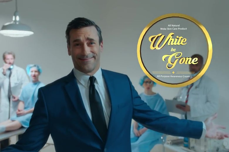 """Jon Hamm, smiling in an insincere-pitchman sort of way, in front of a logo for """"White Be Gone."""""""