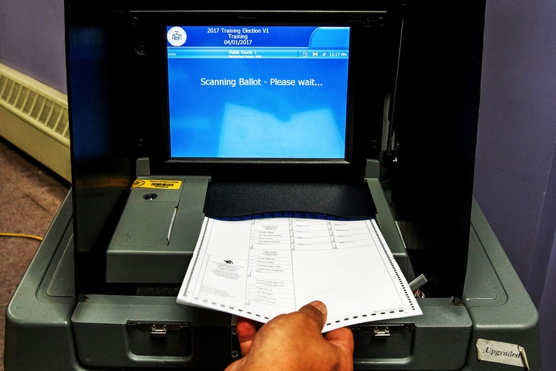 A Board of Elections employee demonstrates the use of a ballot scanner in 2016 in New York City.