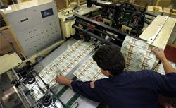 Dollars being printed. Click image to expand.