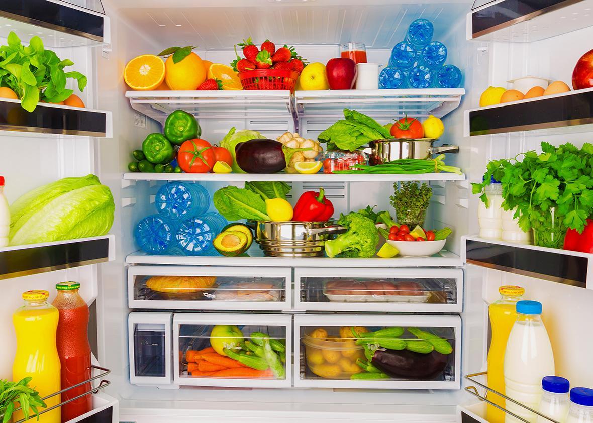 Open fridge full of fresh fruits and vegetable.