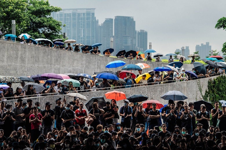 Protesters gather near the Legislative Council building ahead of the arrival of pro-democracy activist Joshua Wong who was earlier released from prison, on June 17, 2019 in Hong Kong, Hong Kong. Hong Kong pro-democracy activist, Joshua Wong, said on Monday after being released from jail that Chief Executive Carrie Lam must step down as he joined protesters against the controversial extradition bill which would allow suspected criminals to be sent to the mainland and place its citizens at risk of extradition to China. (Photo by Carl Court/Getty Images)