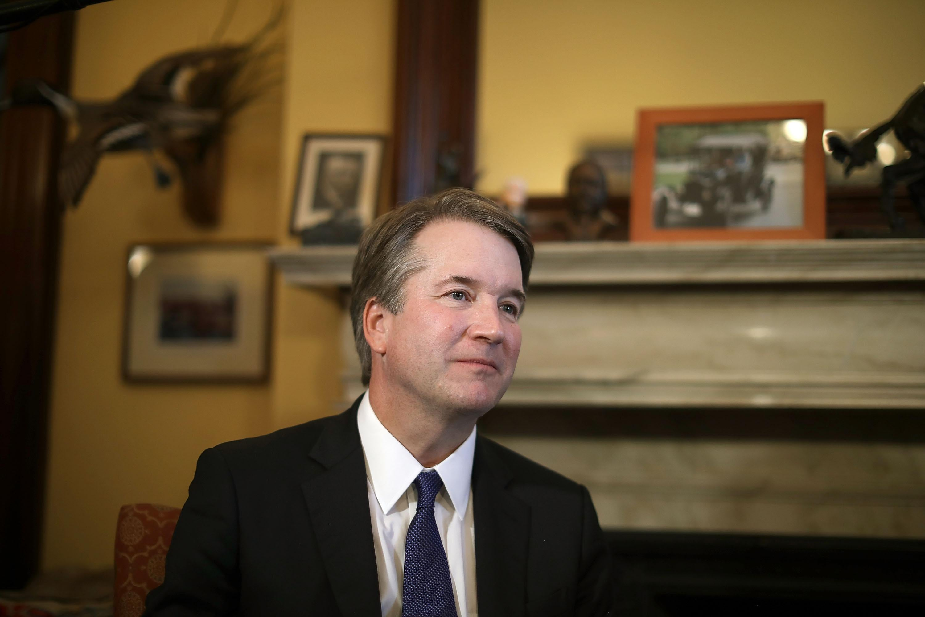 Judge Brett Kavanaugh listens to Sen. Rob Portman talk about Kavanaugh's qualifications.