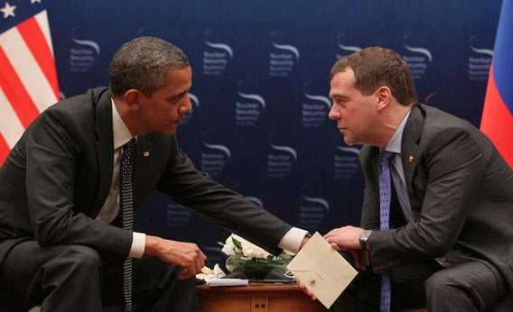 US President Barack Obama, left, speaks with Russian President Dmitry Medvedev, right.