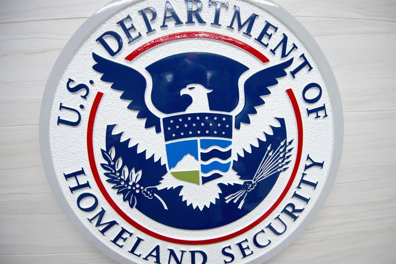 Logo of DHS on a wall.