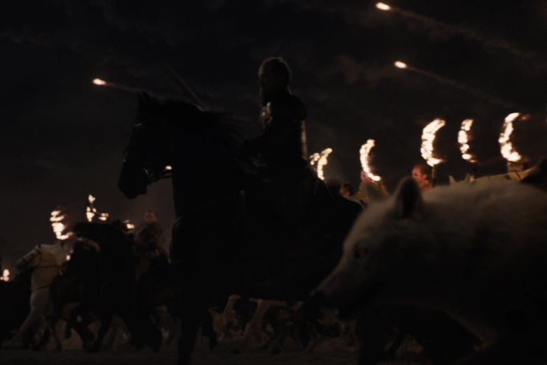 Jorah Mormont on horseback, flanked by a direwolf and rows of mounted Dothraki, charging into battle.