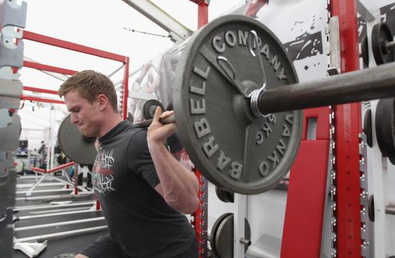 Chris Ashton lifts a barbell during the England training and weights session held at Pennyhill Park on July 20, 2011, in Bagshot, England.