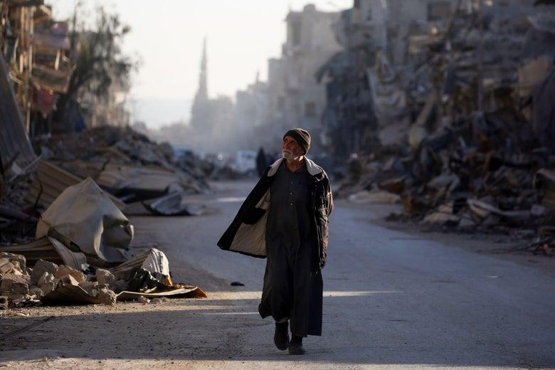 A man walks through a street in Syria's devastated city of Raqqa on Jan. 9.