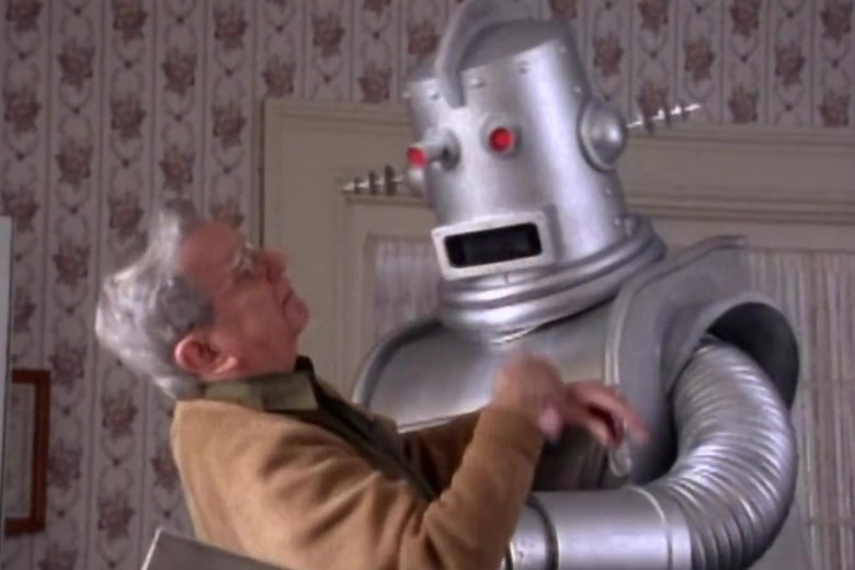 An elderly man is attacked by a robot.