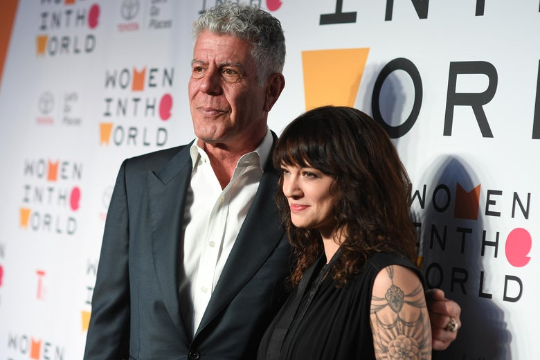 Anthony Bourdain and Asia Argento on a red carpet.