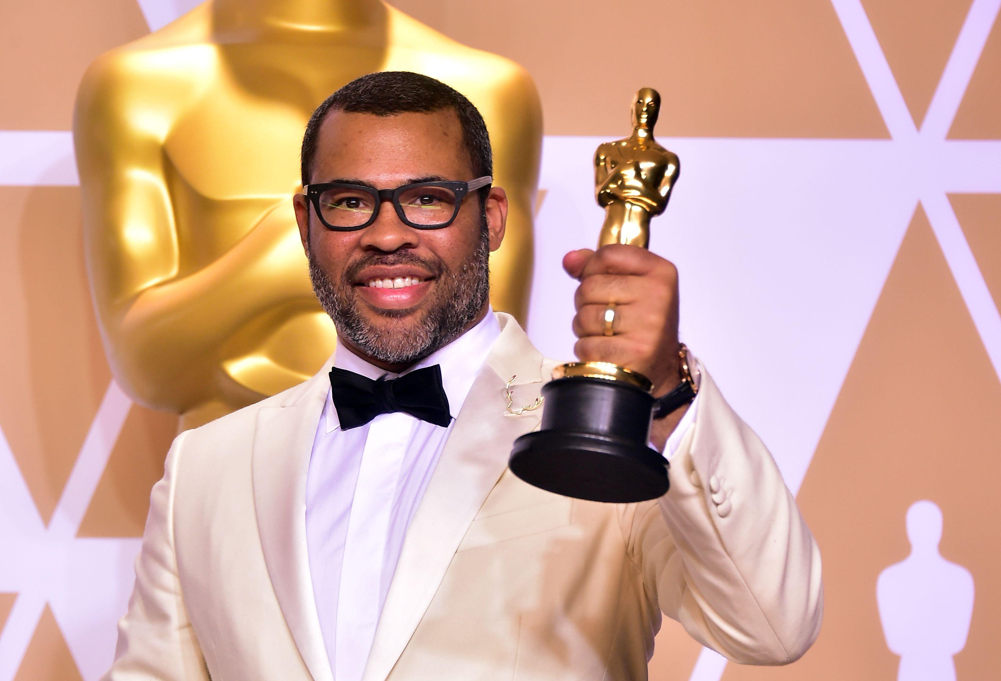 Jordan Peele poses with his Best Original Screenplay Oscar.